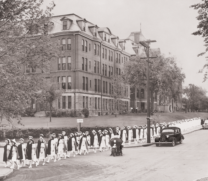 Mercy School of Nursing students walk to graduation in 1946